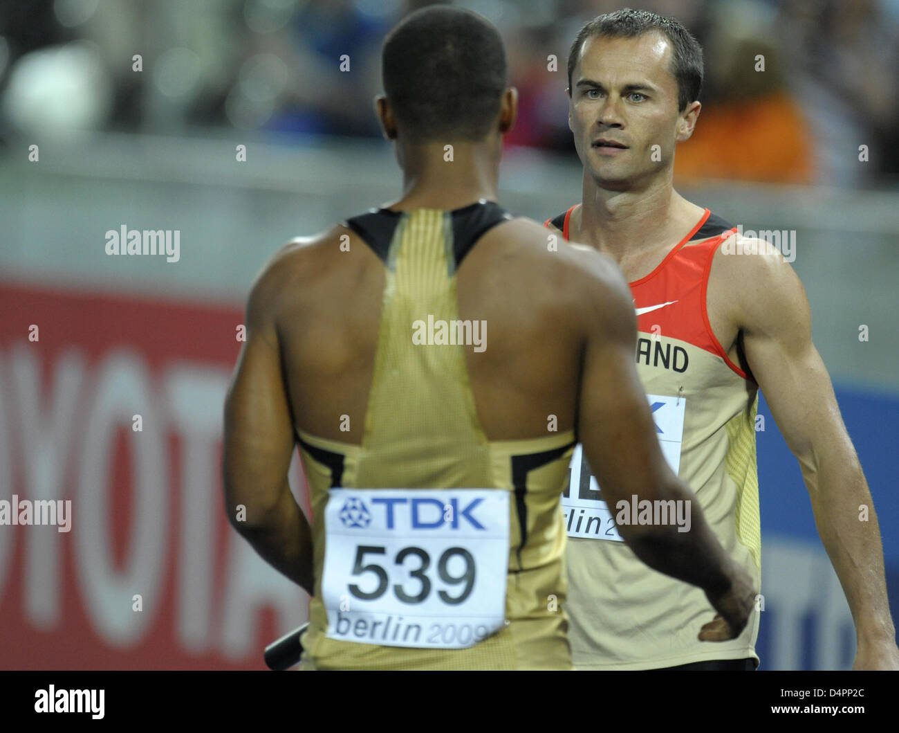 Germans Marius Broening (L) and Alexander Kosenkow talk about the failure of the handover during a men?s 4x100m - Stock Image