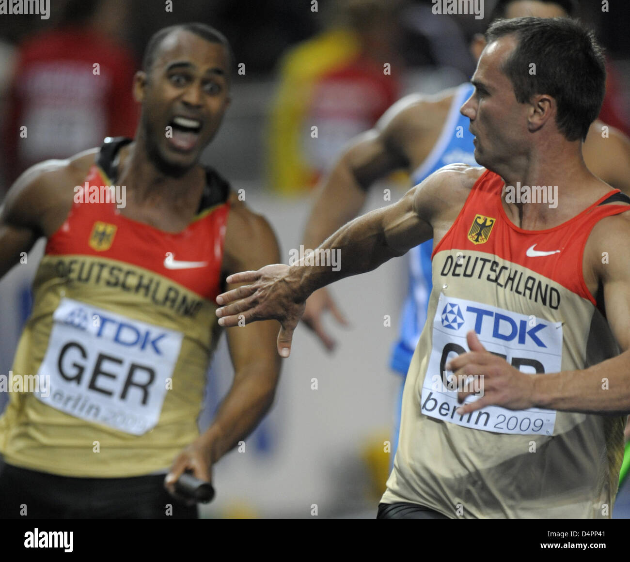 Germans Marius Broening (L) and Alexander Kosenkow fail at the handover during a men?s 4x100m relay heat at the - Stock Image