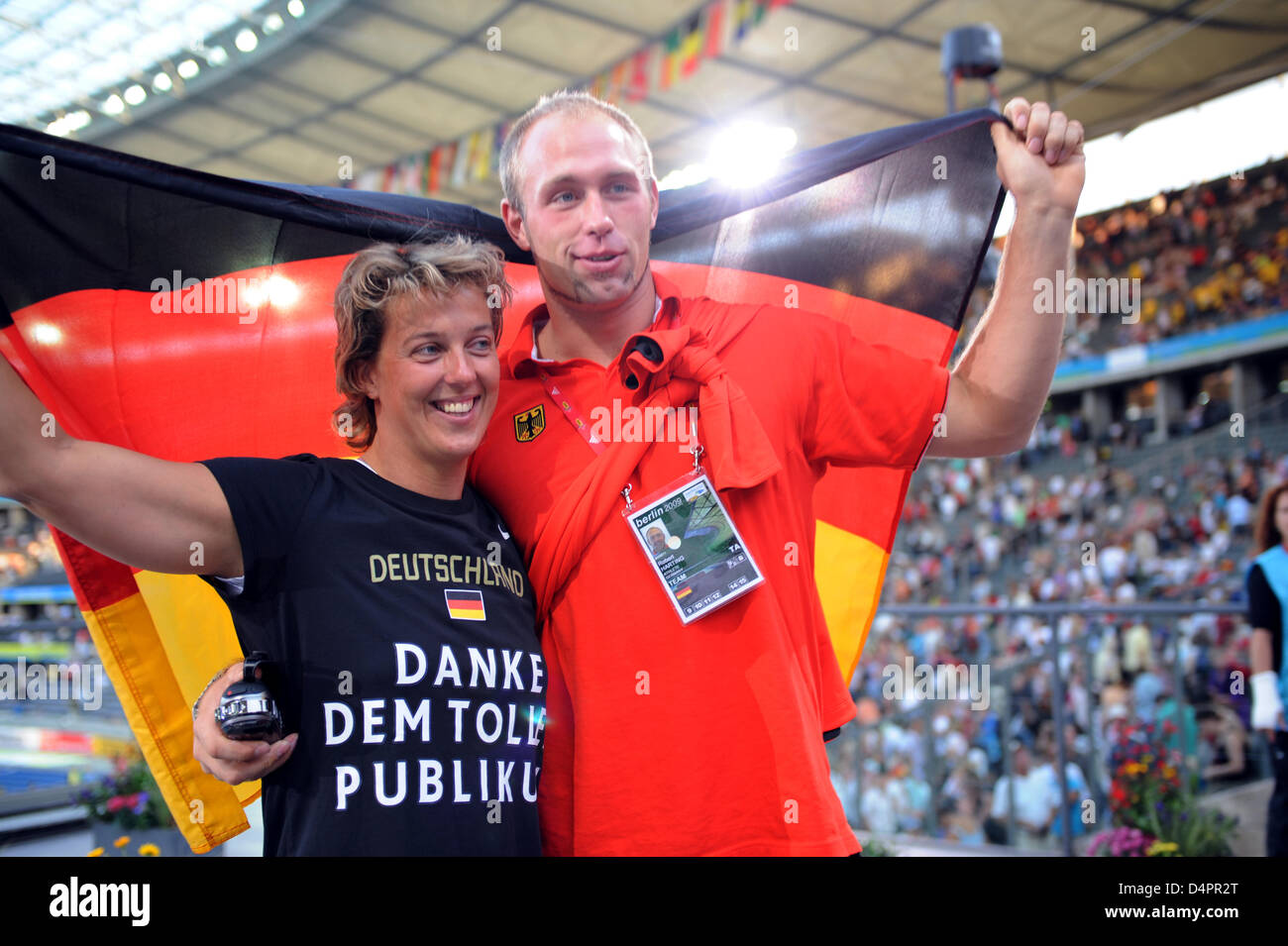 German gold medallists, discus thrower Robert Harting and javelin thrower Steffi Nerius, pose during the closing - Stock Image
