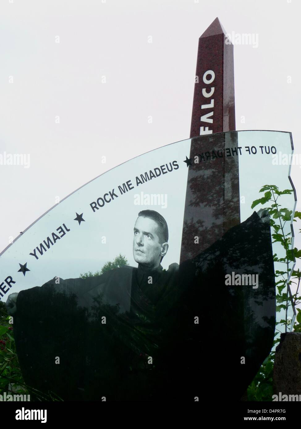 A detail of the the tomb of Austrian pop musician Falco (1957-1998) reads the titles of his greatest hits in Vienna, - Stock Image