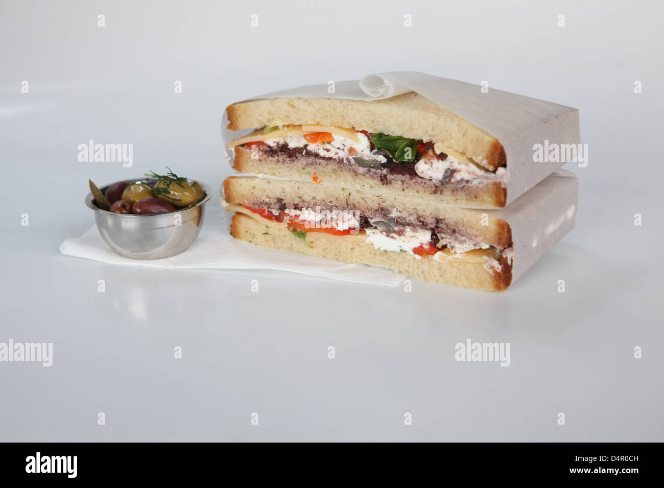 cheese sandwich with tomato and olive side dish - Stock Image