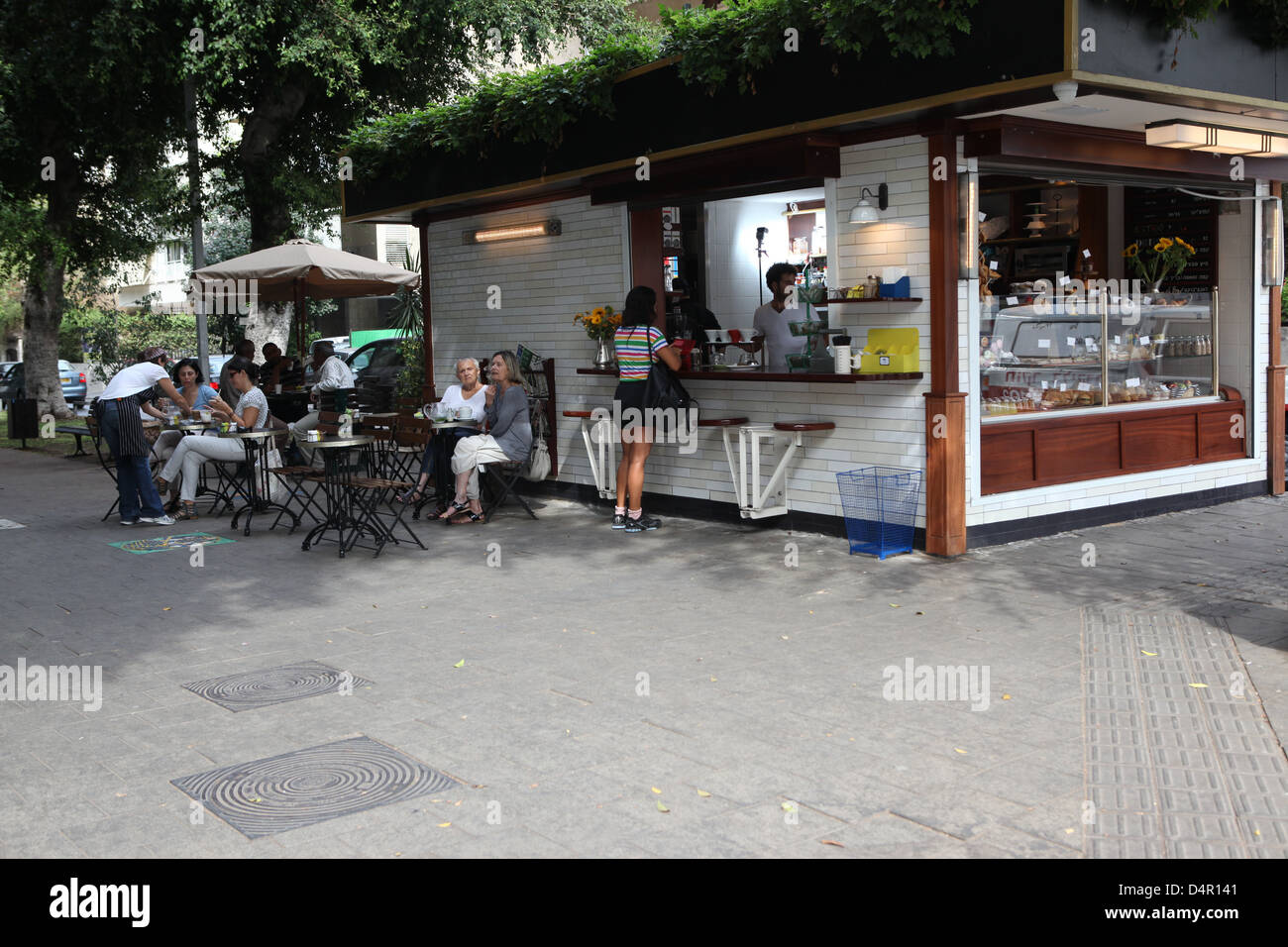 Israel, Tel Aviv, an outdoor coffee bar in Ben-Zion Boulevard - Stock Image