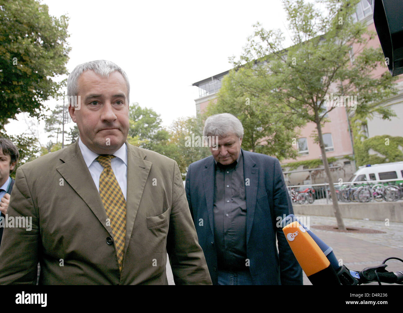 Bavarian Culture Minister Ludwig Spaenle (L) leaves the grounds of the Carolinum school in Ansbach, Germany, 17 - Stock Image
