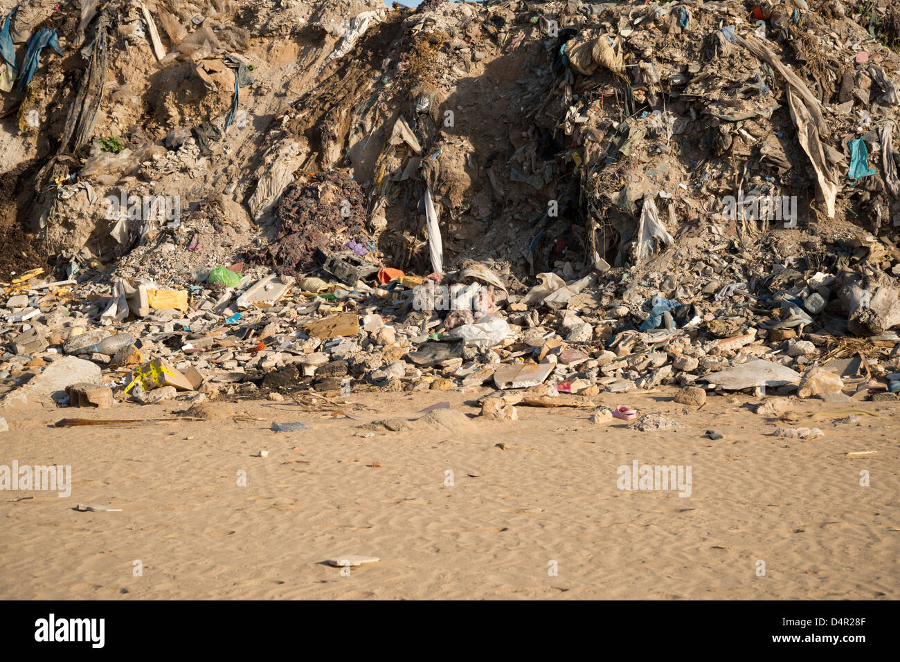 Rubbish dumped on the edge of a beach - Stock Image