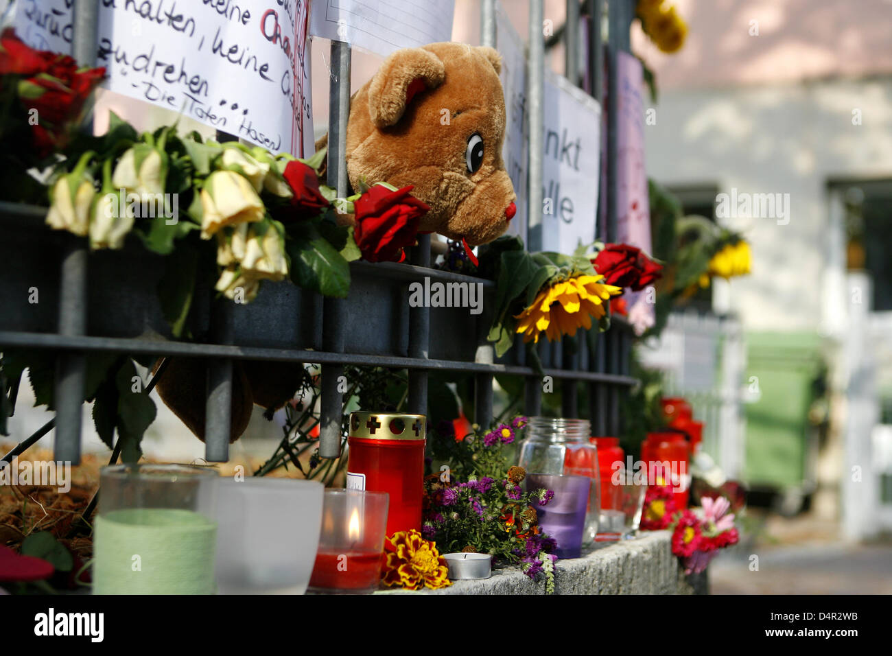 Candles, letters and flowers are placed in front of the Carolinum school in memory of the casualties of the assault - Stock Image