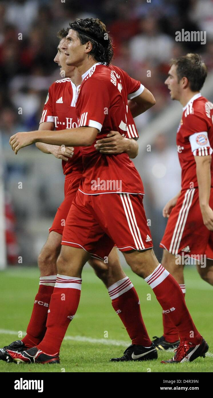 Munich?s Mario Gomez (front) cheers about his 2-0 score with teammates Miroslav Klose (L) and Philipp Lahm (R) during - Stock Image