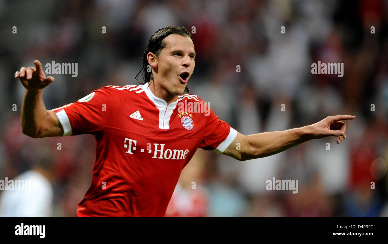 Munich?s Daniel van Buyten cheers about his 3-0 score during the German DFB Cup second round match FC Bayern Munich - Stock Image