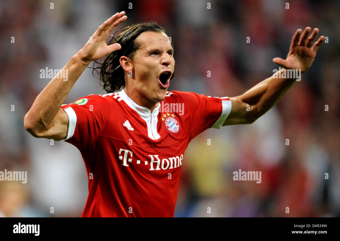 Munich?s Daniel van Buyten cheers about his 3-0 score during the German DFB Cup second round match FC Bayern Munich Stock Photo