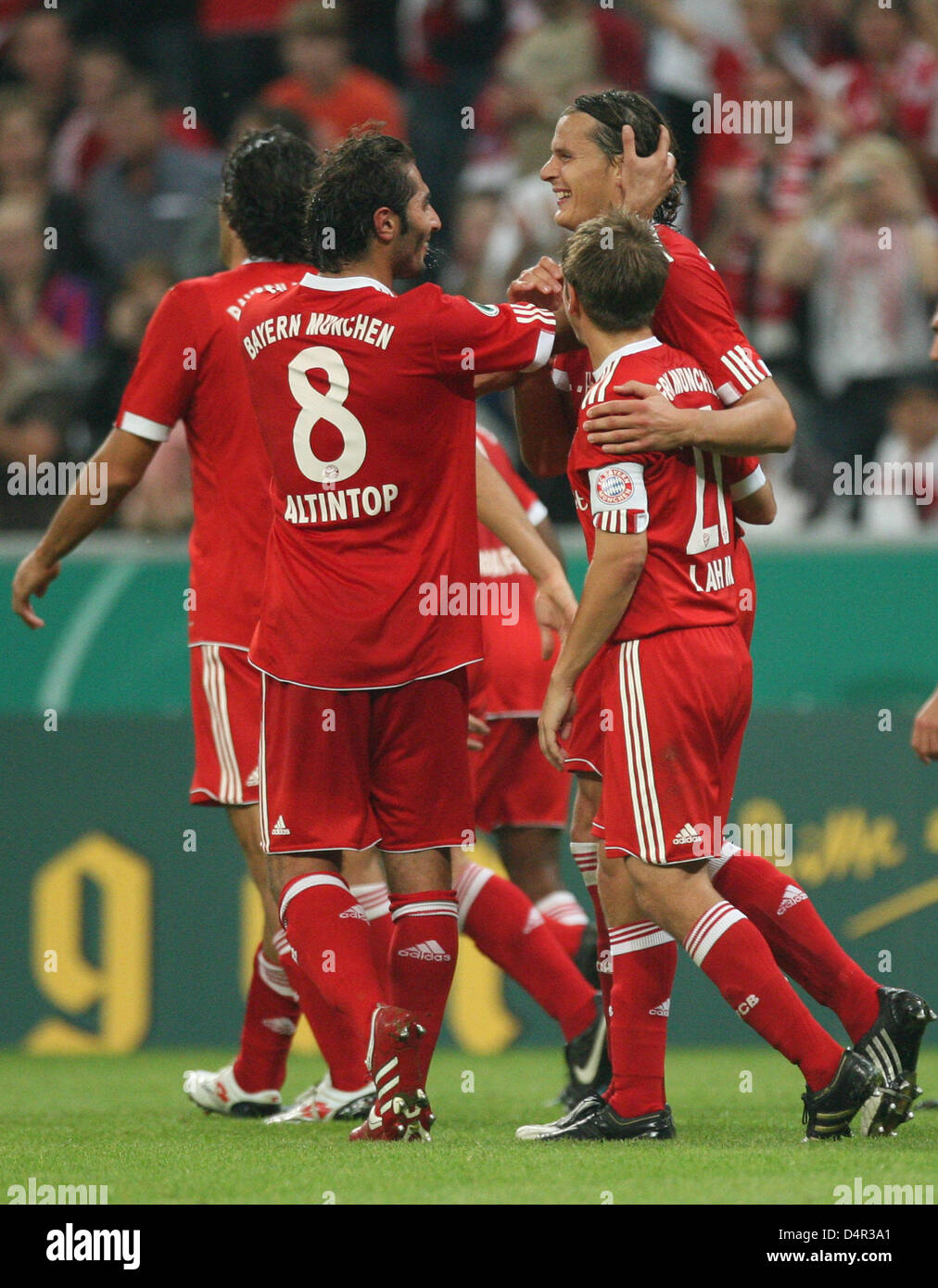 Munich?s Daniel van Buyten (back R) cheers about his 3-0 score with teammates during the German DFB Cup second round - Stock Image