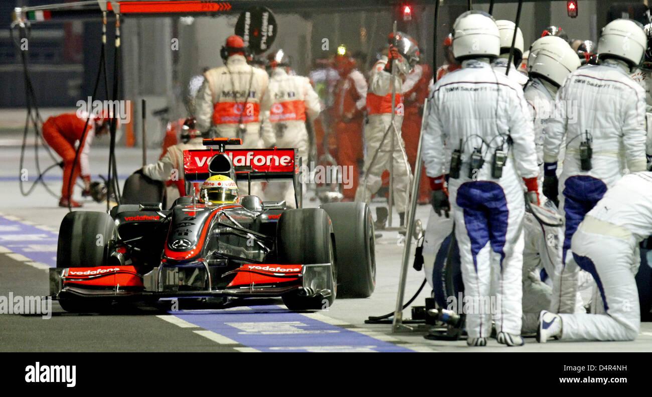 British Formula One driver Lewis Hamilton of McLaren Mercedes pits during the Formula 1 Singapore Grand Prix  at - Stock Image