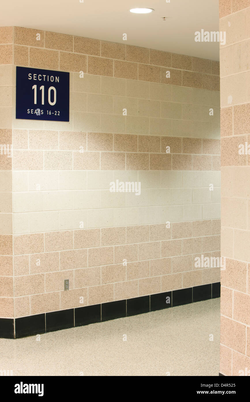 Section number sign on tiled wall - Stock Image