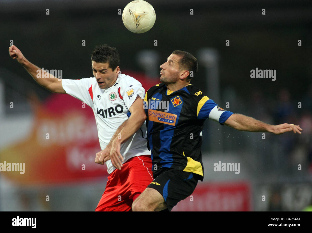 Koblenz?s Shefqi Kuqi (R) and Oberhausen?s Marinko Miletic (L) rise for a header during the German Bundesliga 2nd - Stock Image