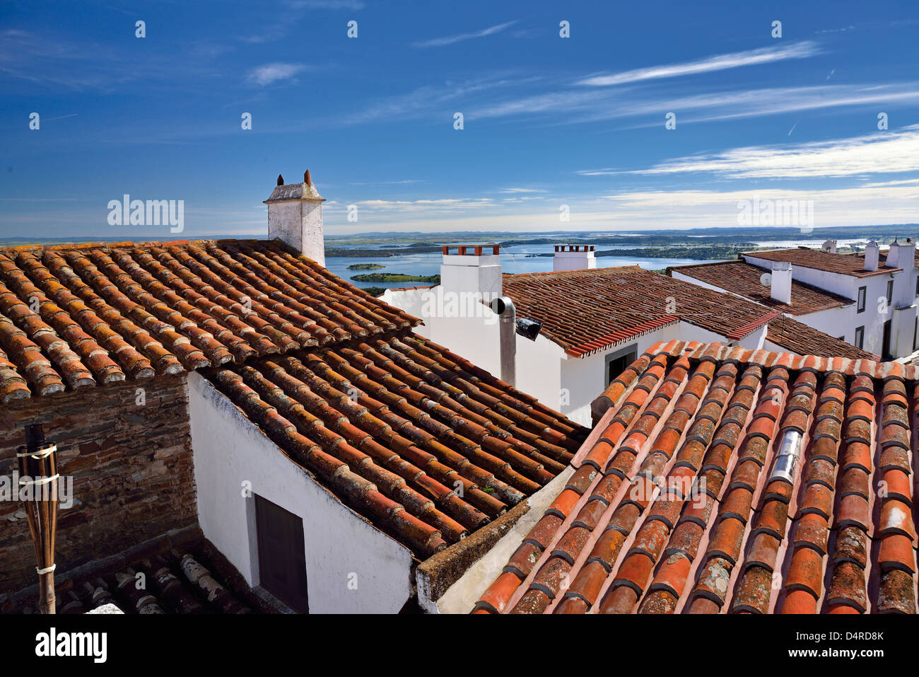 Portugal, Alentejo: Overview to the roofs of medieval village Monsaraz and to the Barrage of Alqueva - Stock Image