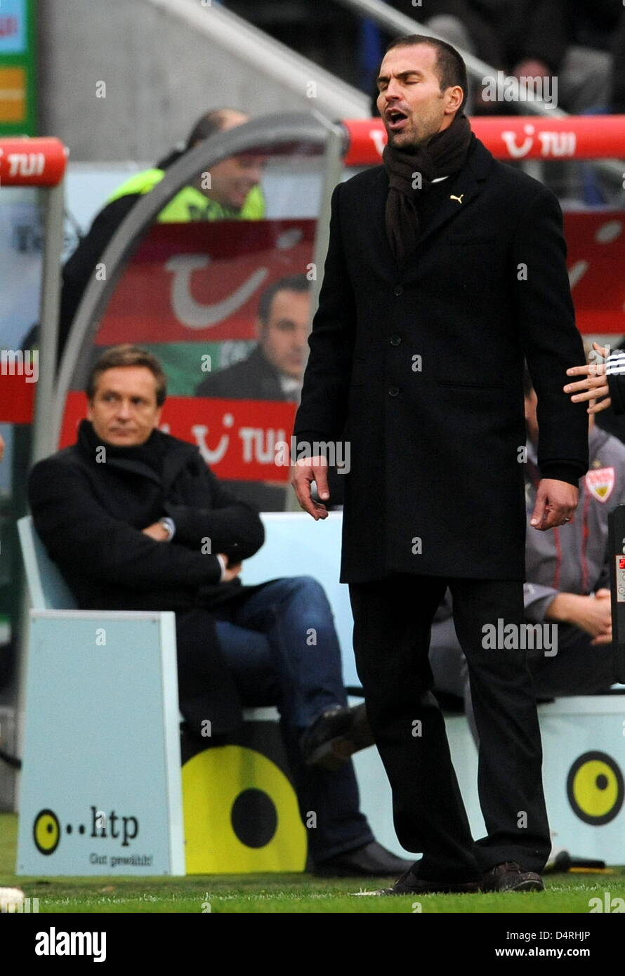 Stuttgart?s head coach Markus Babbel (R) gives instructions next to manager Horst Heldt during the German Bundesliga Stock Photo
