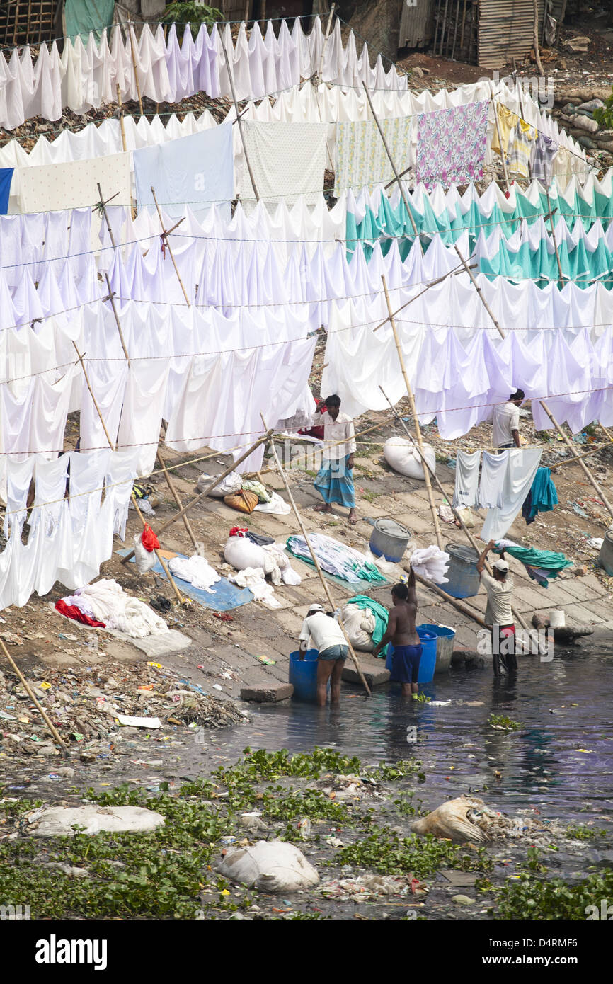 Hospital laundry washed in the polluted Buriganga river - Stock Image