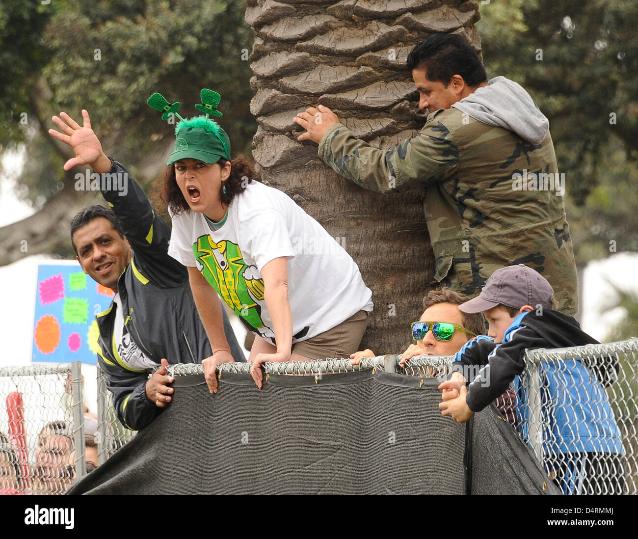 March 17,2013. Santa Monica Calif. USA  Friends and family members watch the runners at the finish line during the - Stock Image