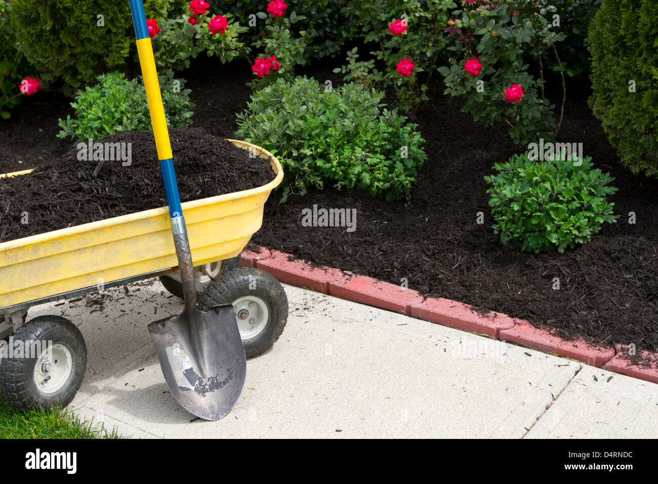 Its about that time to mulch around the neighborhood. Stock Photo