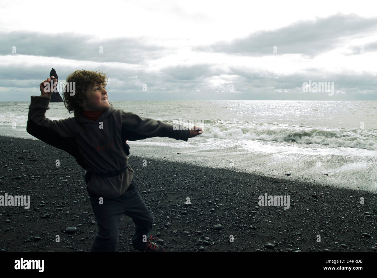 Boy who ricochets on the beach Iceland - Stock Image