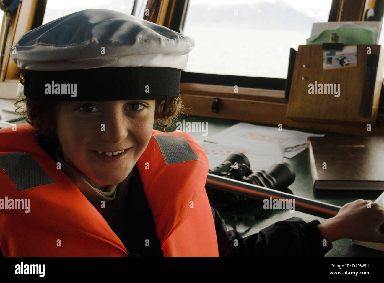 Boy playing captain, cockpit - Stock Image