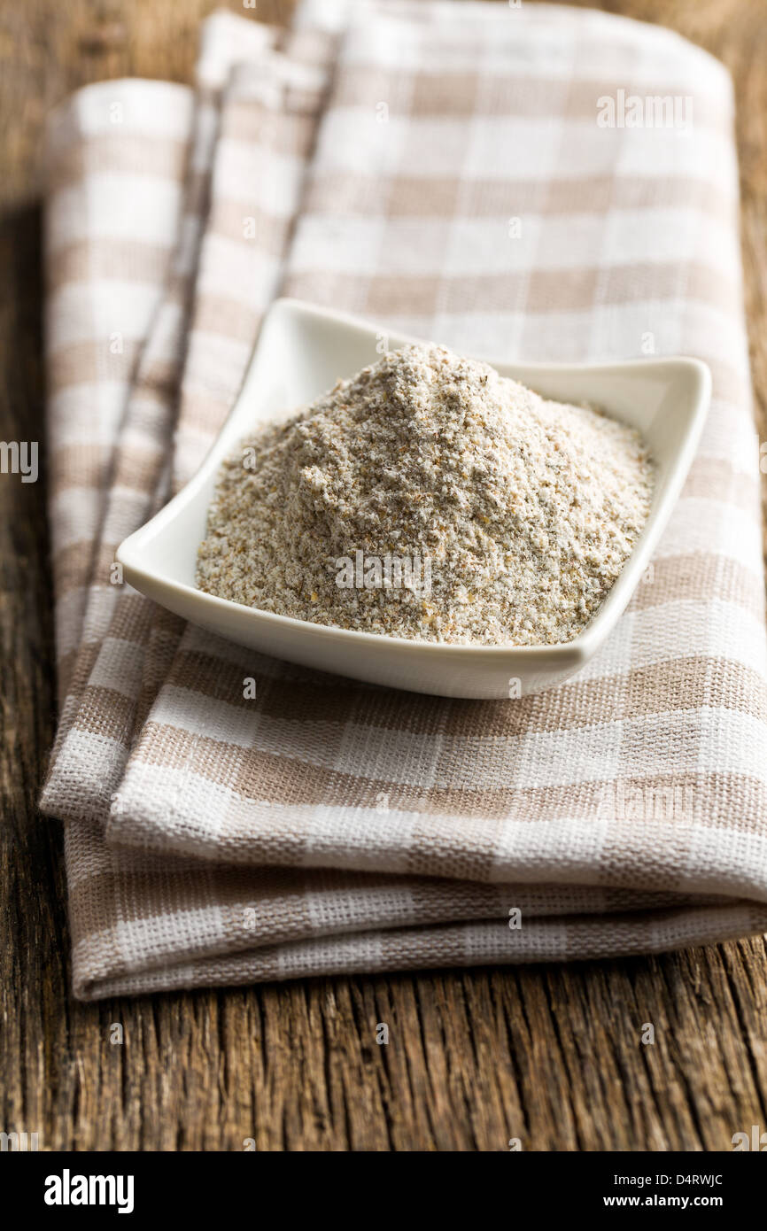 the wholemeal flour in ceramic bowl - Stock Image