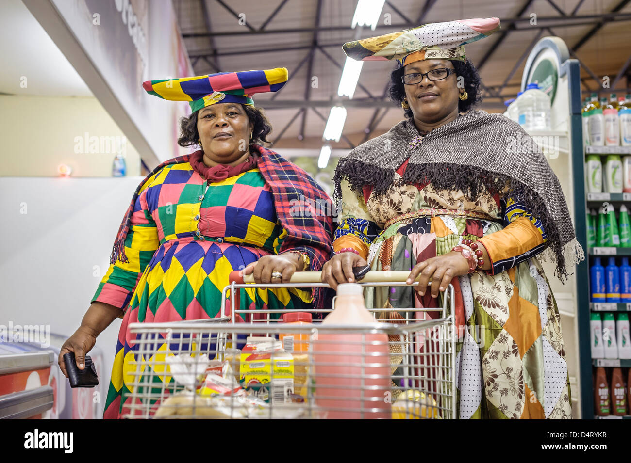 Herero women shopping, Opuwo, Namibia, Africa - Stock Image
