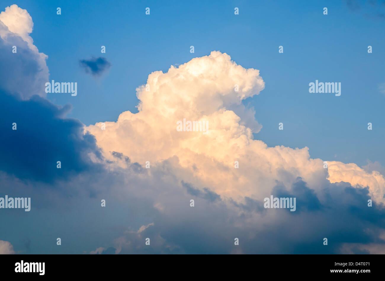 A Cumulonimbus cloud against a blue sky. - Stock Image