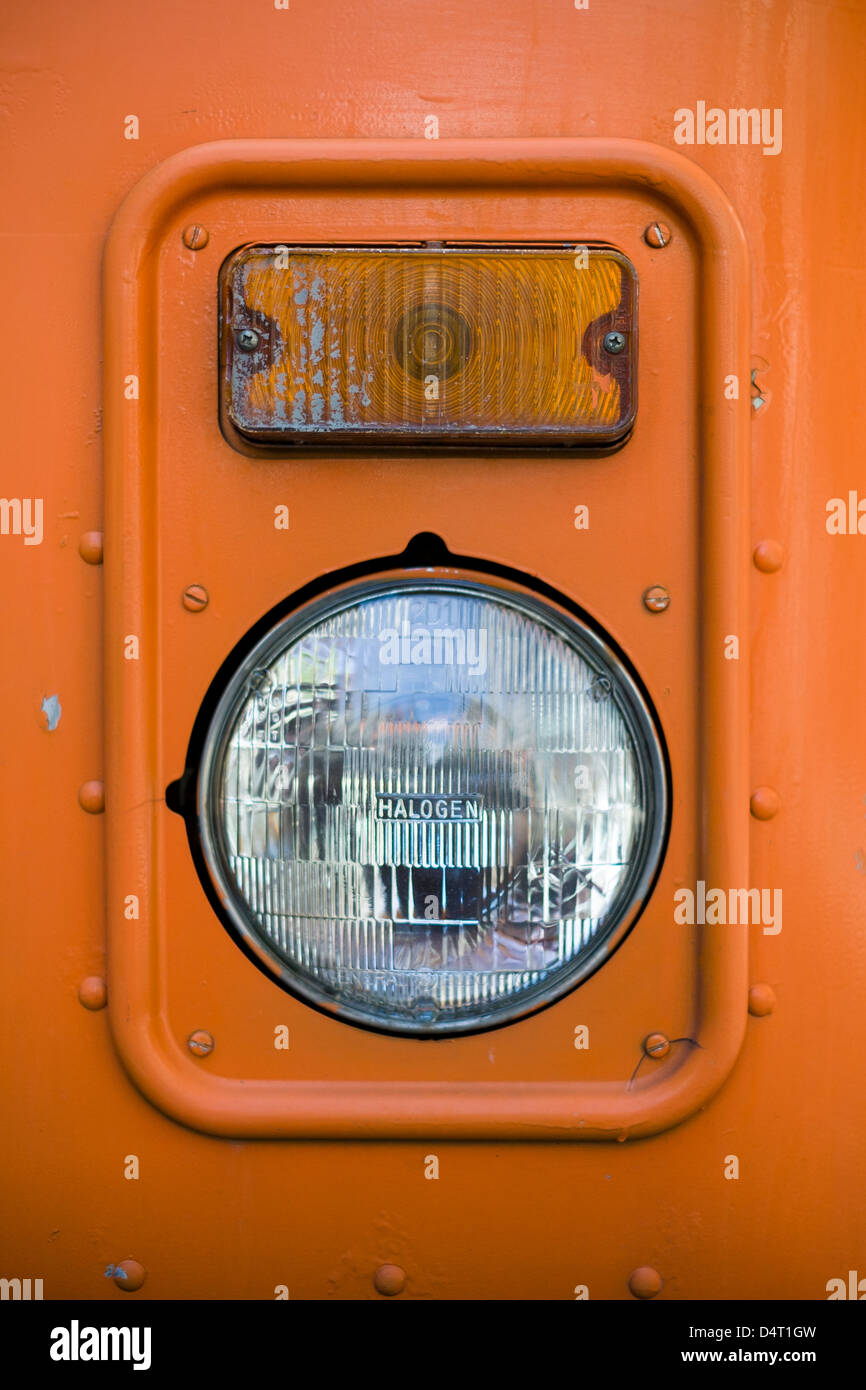 Old orange bus headlight - Stock Image