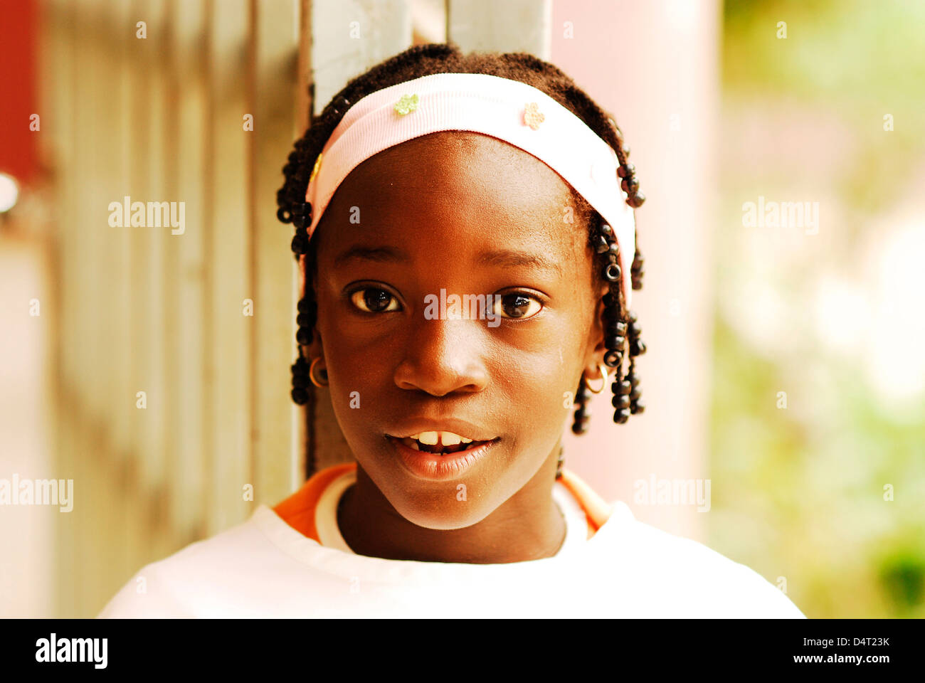 Africa, Angola, Luanda, close-up portrait of a cheerful little African girl in a headband. (MR) - Stock Image
