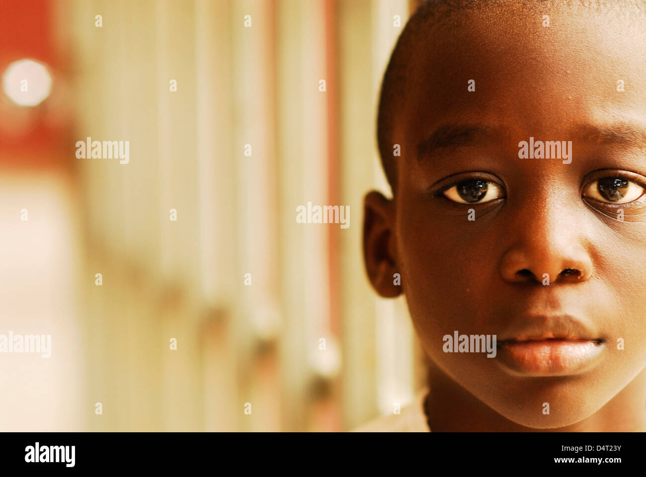 Africa, Angola, Luanda, close-up portrait of a bald African boy in contemplation. (MR) - Stock Image