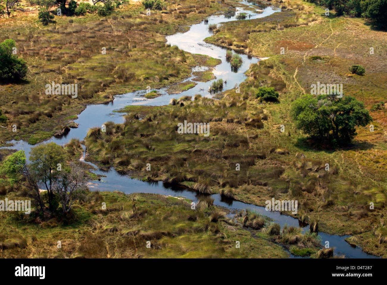 Botswana, Okavango Delta. Okavango tributary and landscape. - Stock Image