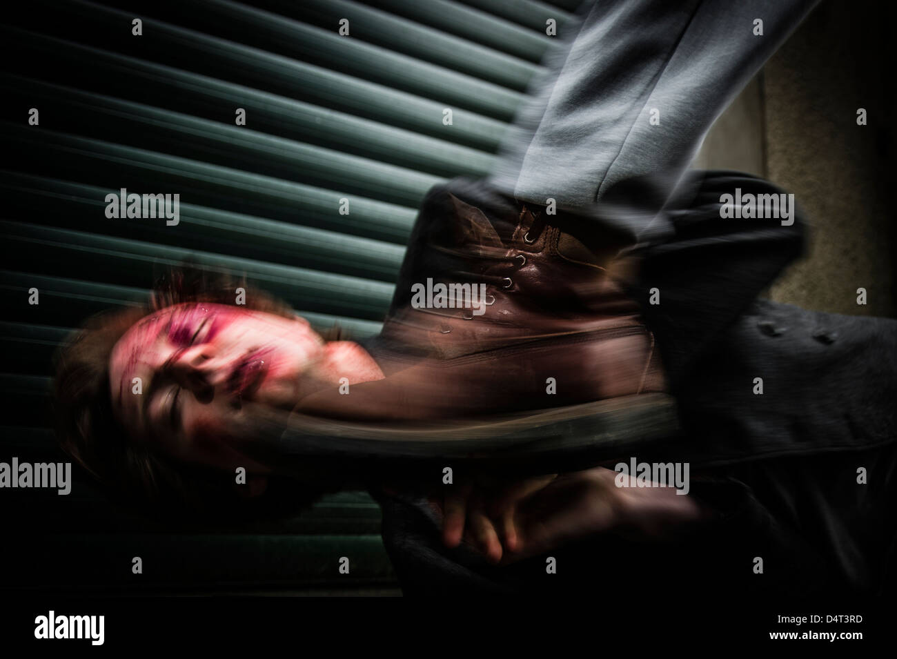 A man being attacked, beaten, savagely kicked in the head, UK , homophobic attack assault - Stock Image