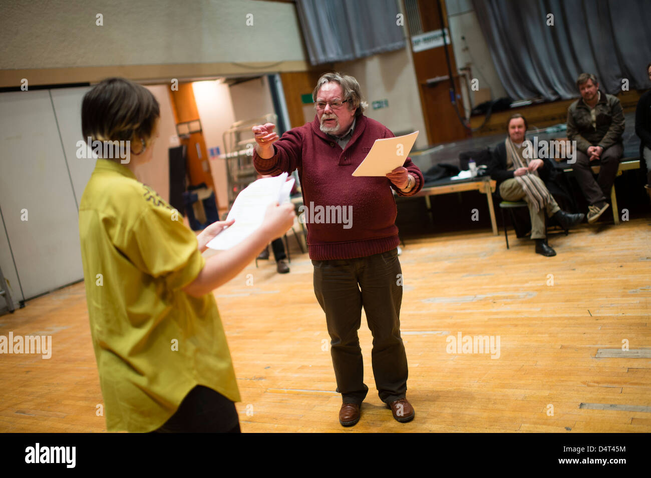 Actors and director holding their scripts rehearing a new play drama in a theatre workshop studio. UK - Stock Image