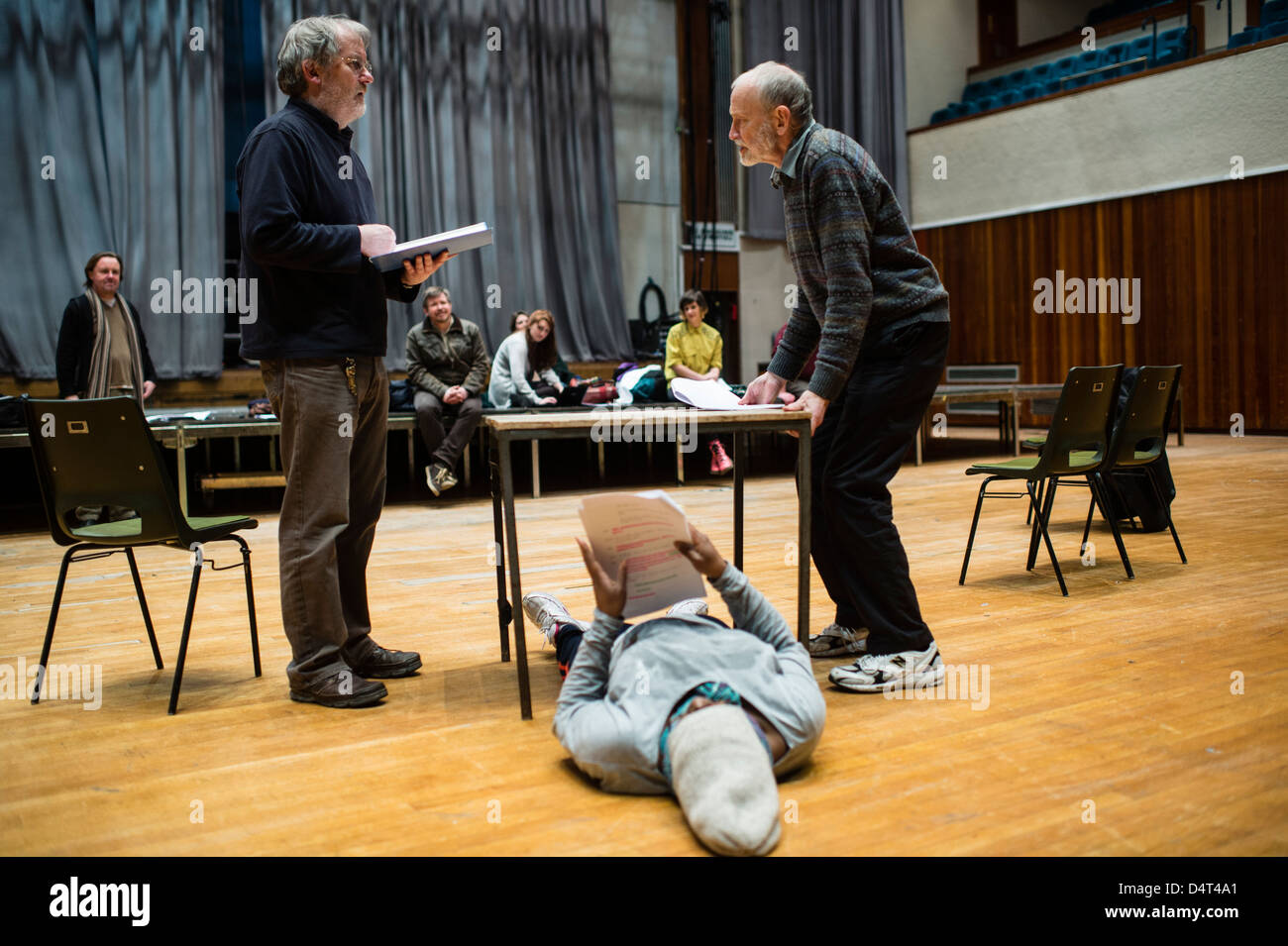 Actors holding their scripts rehearing a new play drama in a theatre workshop studio. UK - Stock Image