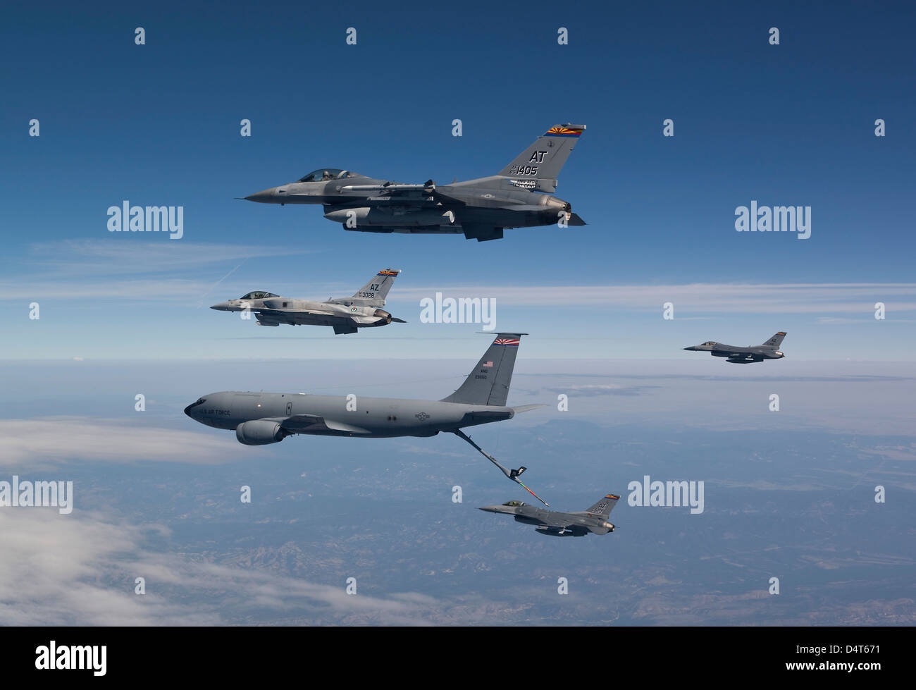 Four F-16's and a KC-135 from the Arizona Air National Guard fly in formation during a training mission over - Stock Image