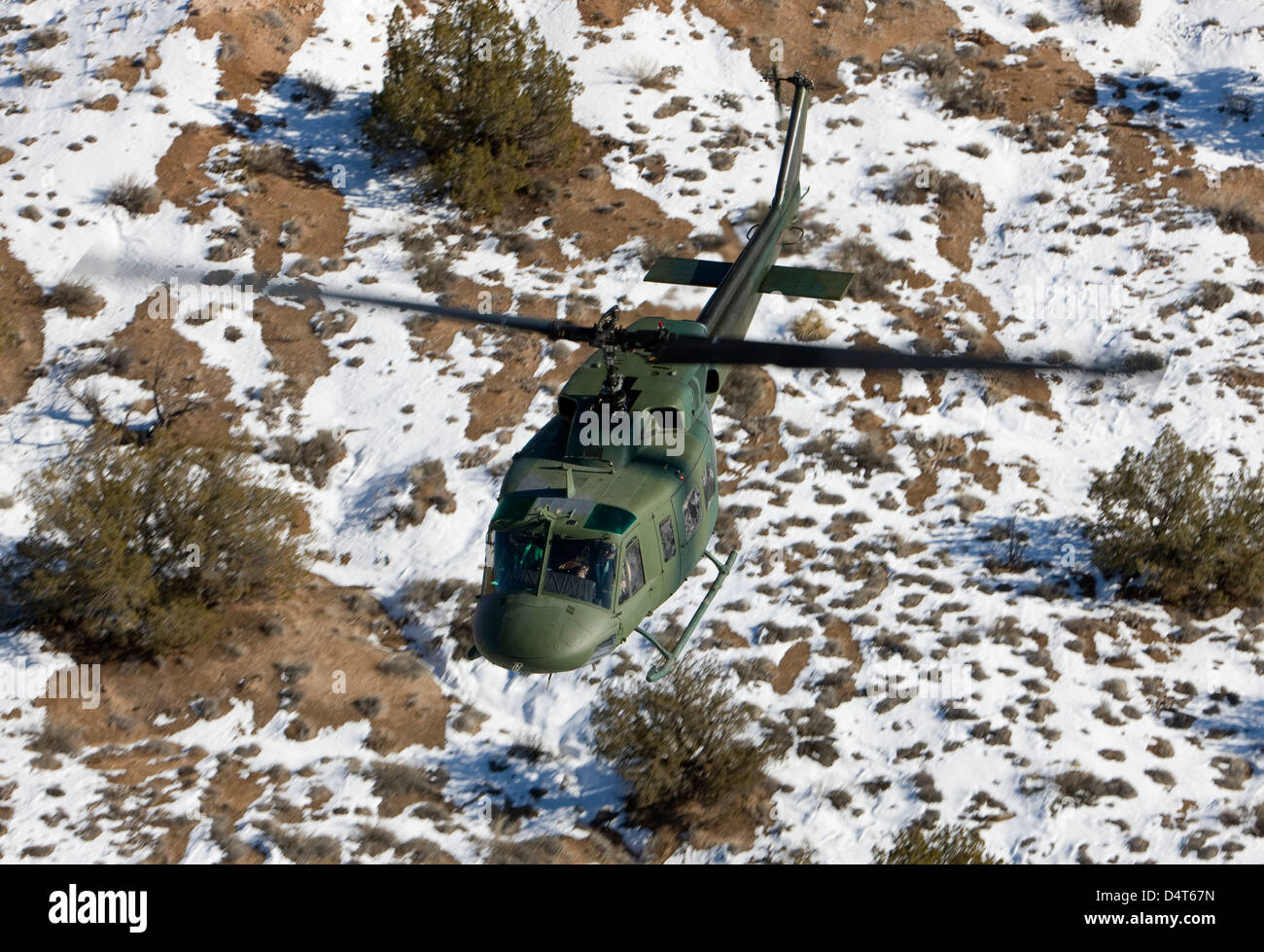 A UH-1N Twin Huey from the 512th RQS flies a training mission near Kirtland Air Force Base, New Mexico. - Stock Image