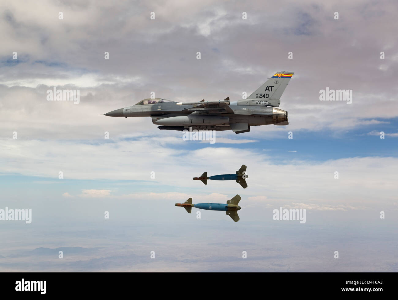An F-16 Fighting Falcon releases two GBU-24 laser guided bombs. - Stock Image