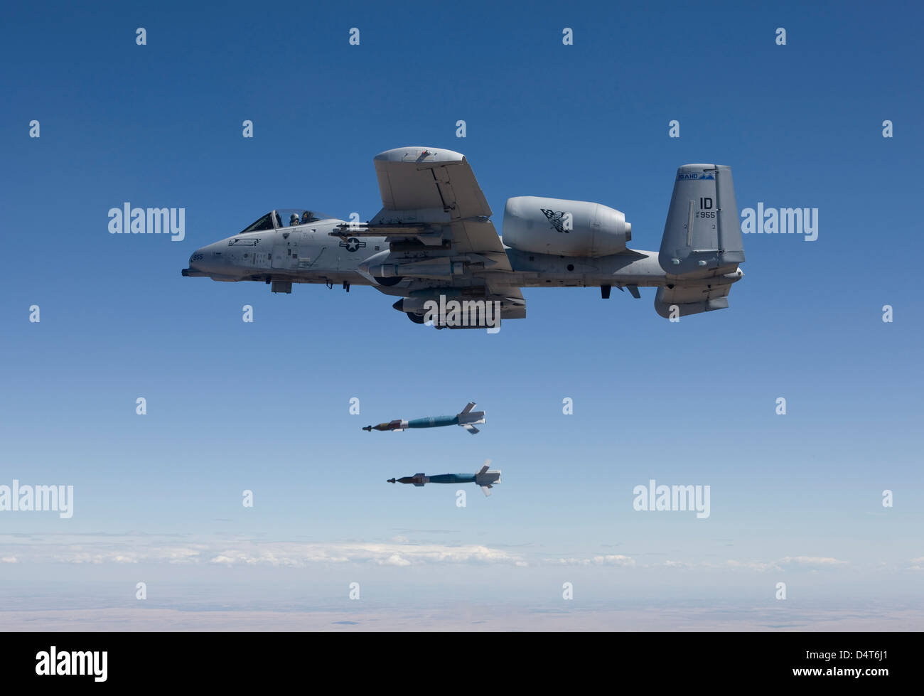 An A-10C Thunderbolt releases two GBU-12 laser guided bombs. - Stock Image