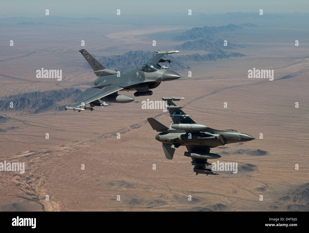 Two F-16's from the 56th Fighter Wing at Luke Air Force Base, Arizona, manuever on a training mission over the - Stock Image