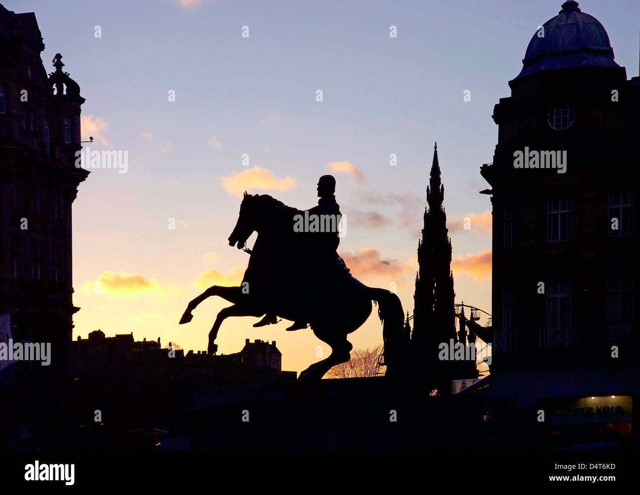 statue of mounted duke of wellington in sillouette in front of register house - Stock Image