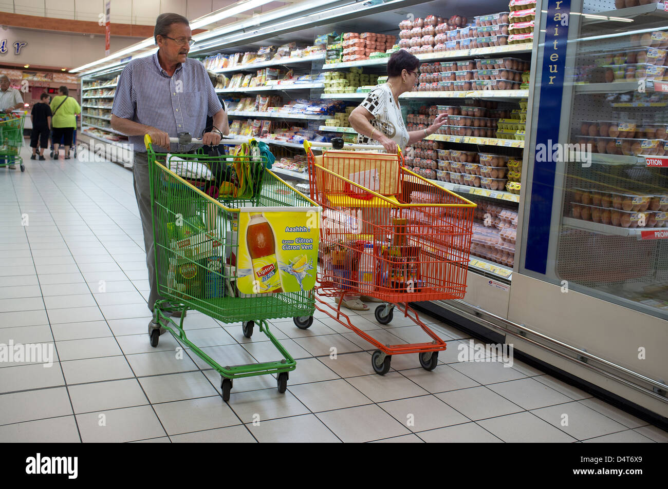 Colmar, France, a couple shopping in a supermarket Leclerc