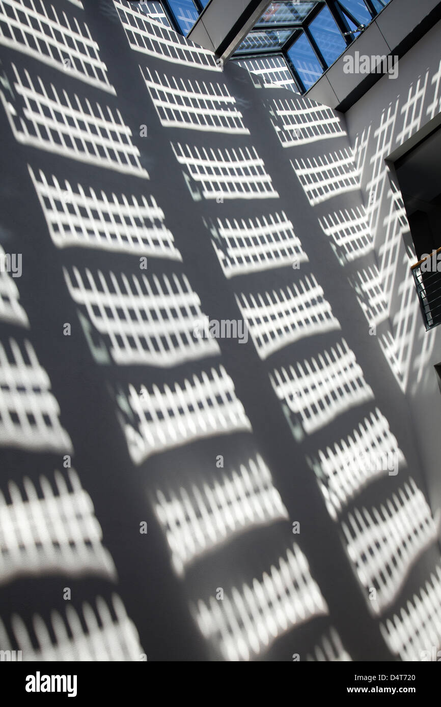 Freiburg, Germany, Shadow of solar panels at the Fraunhofer Institute - Stock Image