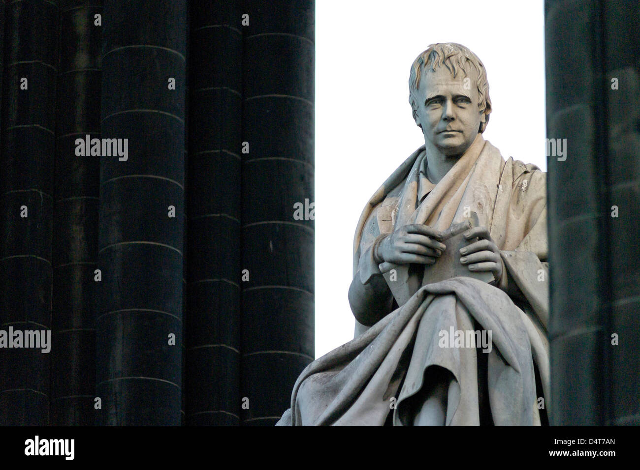 detail of alabaster statue of sir walter scott at foot of monument - Stock Image