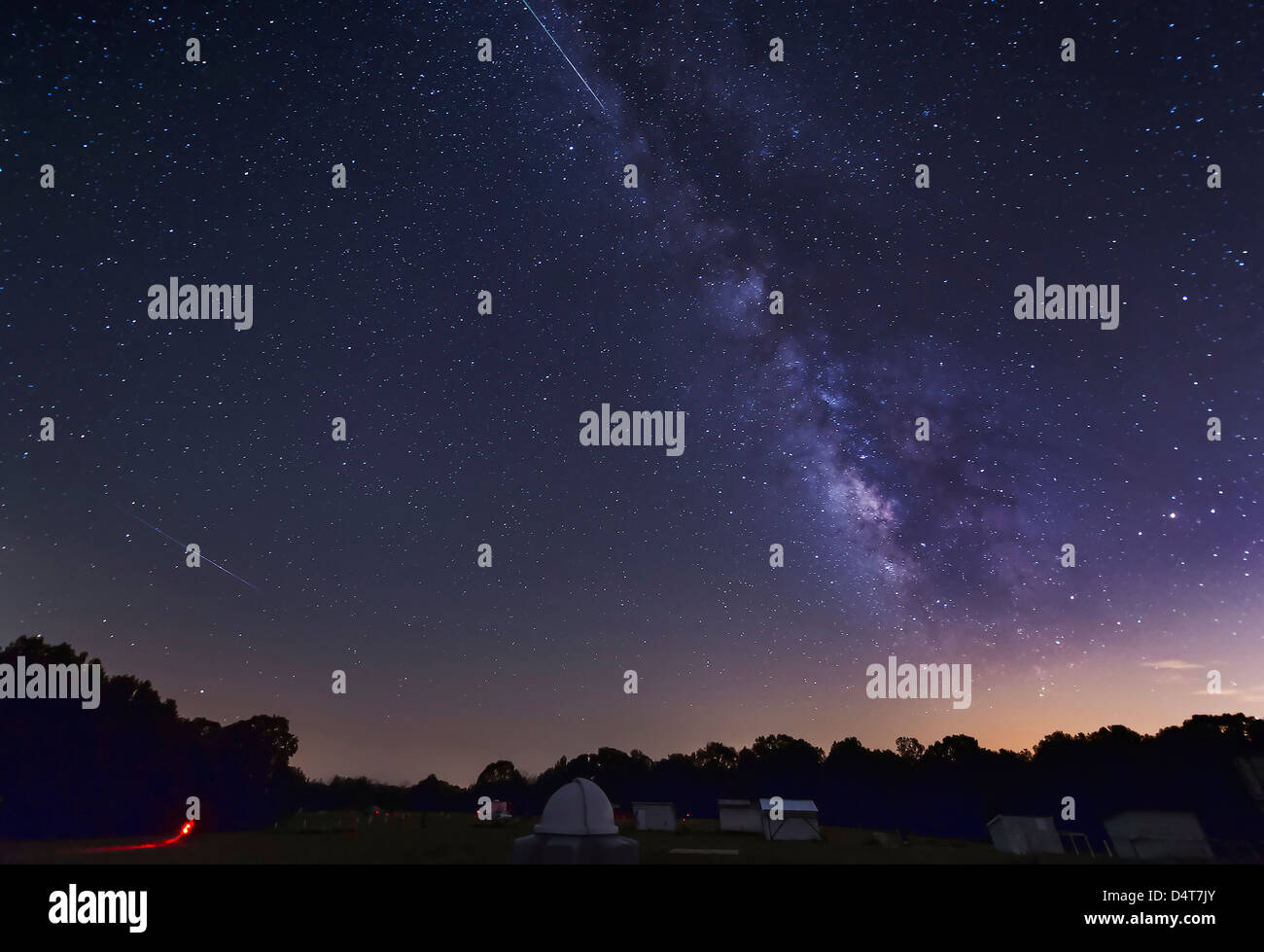 Two Perseid meteors streak across the Milky Way during the 2012 meteor shower in Oklahoma. Stock Photo