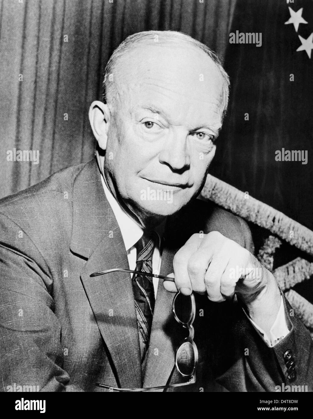 Digitally restored vintage American history photo of President Dwight Eisenhower holding a pair of glasses. - Stock Image