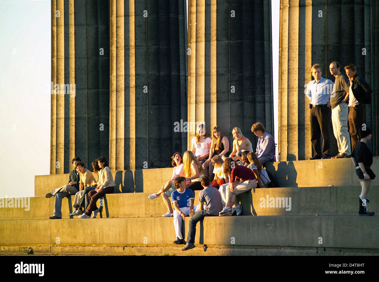 pillars of national monument - calton hill with sun soaked tourists - Stock Image