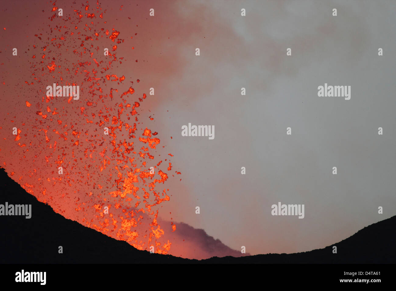 Lava bombs expelled during a basaltic fissure eruption on Nyamuragira Volcano. - Stock Image