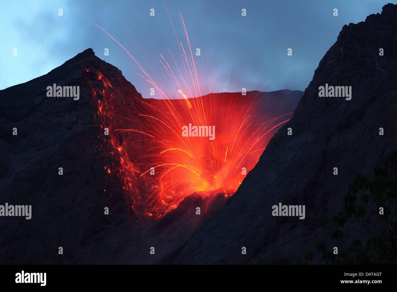 Strombolian type eruption of Batu Tara volcano, Indonesia. - Stock Image
