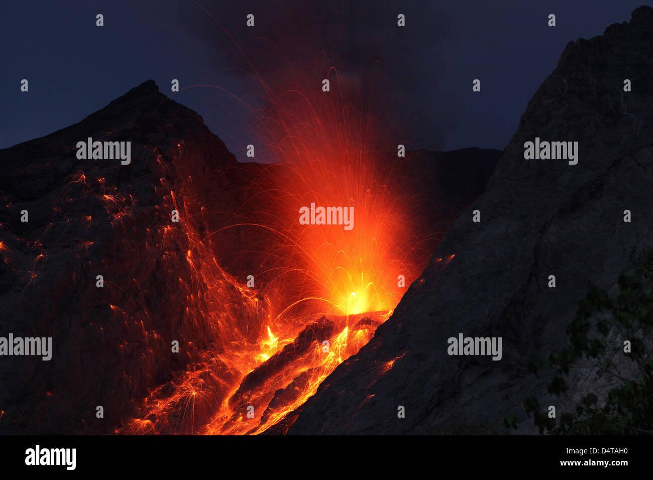Strombolian type eruption of Batu Tara volcano, Indonesia. Stock Photo