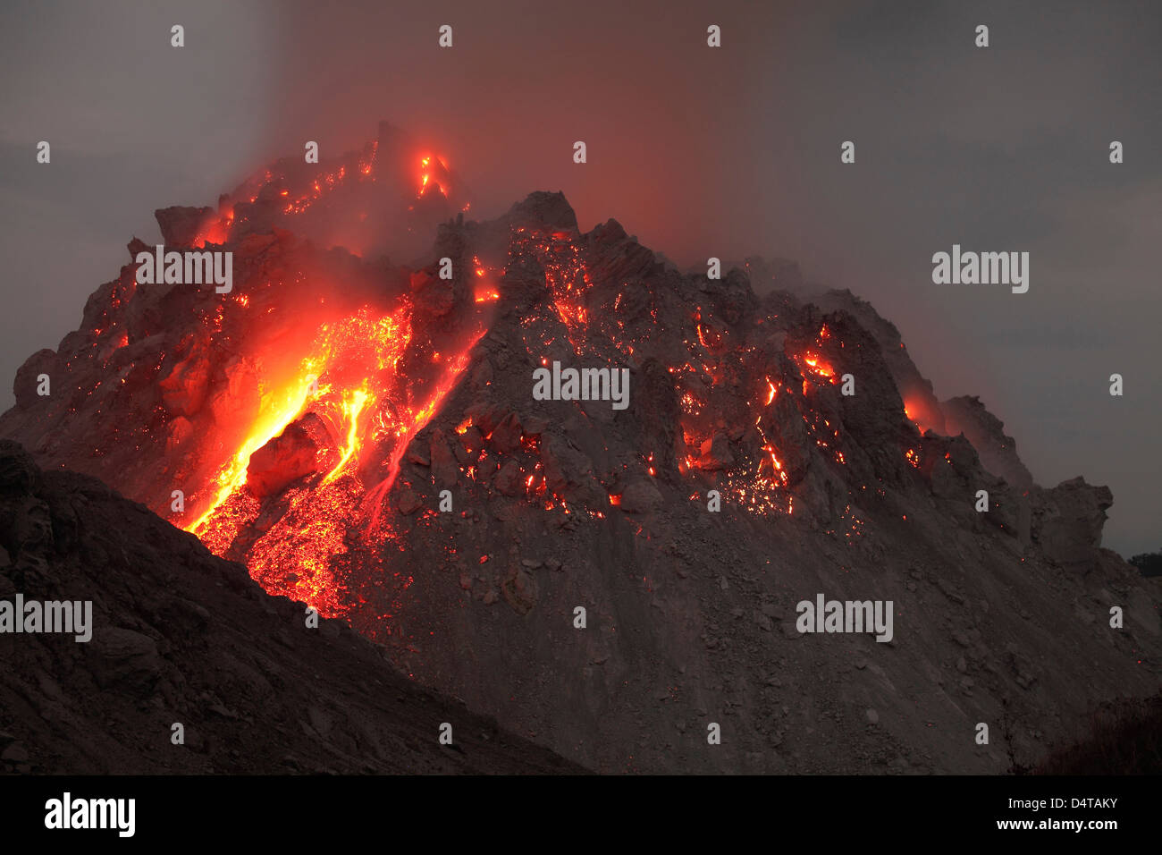 November 30, 2012 - Glowing Rerombola lava dome of Paluweh volcano during eruption in 2012, Flores, Indonesia. - Stock Image