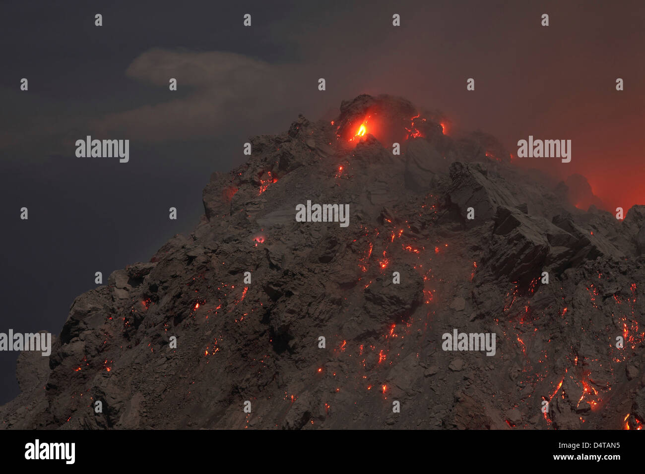 December 1, 2012 - Glowing summit of Rerombola lava dome of Paluweh volcano during eruption in 2012, Flores, Indonesia. - Stock Image